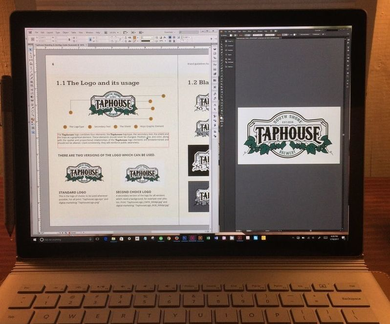 Photo of a computer screen with the Taphouse logo and the brand styling guide layout digital files.